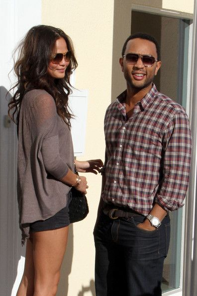 John Legend and Chrissy Teigen Photos Photos - Singer John Legend and girlfriend Christine Teigen have lunch at .Sunset Plaza. While walking to the car it looks like Christine had some minor wardrobe trouble with her skirt unraveling itself. Photograph: © J. - John Legend and Christine Teigen at Lunch at Sunset Plaza