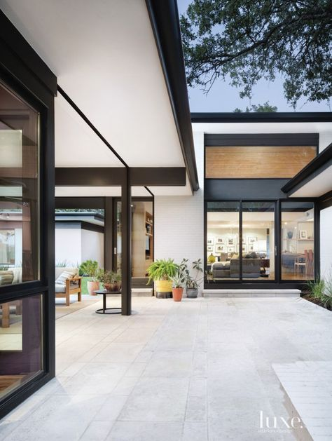 A courtyard with Gray Lueders limestone pavers connects the main home and a detached casita, which has many uses, including the husband's office and a family room. The area also provides a place for the children to play and ride their bikes.
