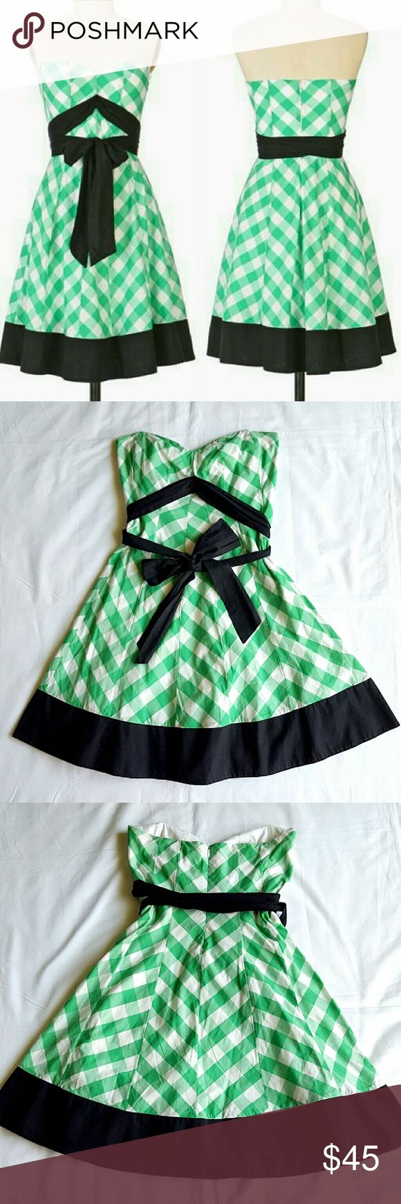 Anthro Orchard Dress By Odille. A lush canopy of green-and-white gingham. Light boning at the bust adds structure while a crinoline provides a full-skirted shape. DETAILS: Tacked-down sash Back zip Cotton; cotton lining Machine wash Worn very few times. Has one small tear at inside lining, the bottom of zipper (last pic) totally invisible as is inside). Other than that in excellent condition. Anthropologie Dresses Midi