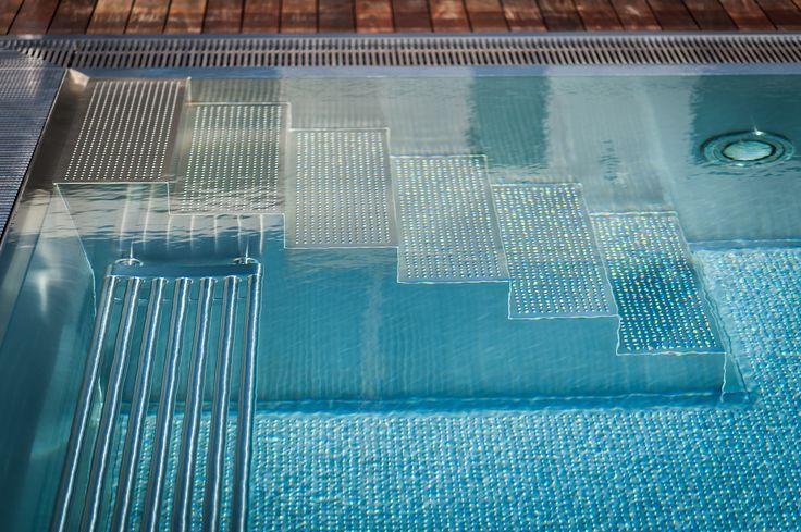 Stainless steel pool with overflow trough around entire perimeter