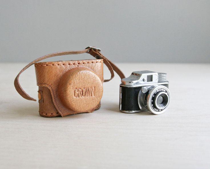 miniature crown spy camera & leather case.