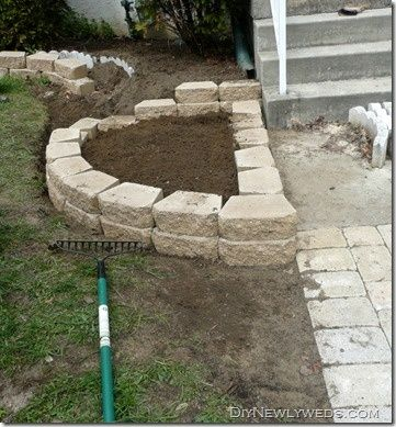 DIY retaining wall/flower bed from DIY Newlyweds blog
