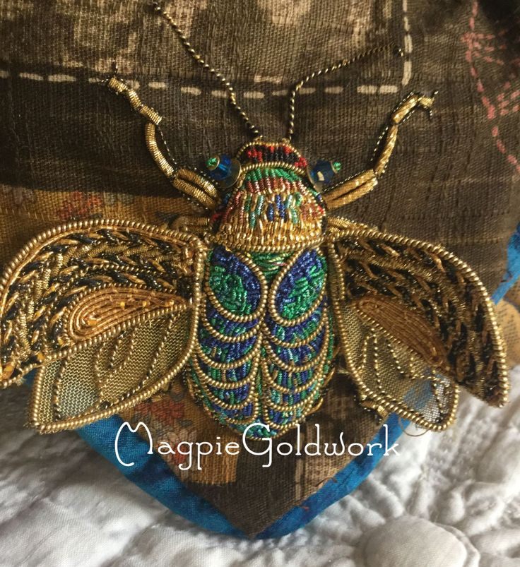 Pretty little beaded bumble bee - or is it a beetle, perhaps a scarab?