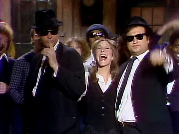 Top 10 Examples of Star Wars On TV - Star Wars On Saturday Night Live (1978)  carrie-fisher-snl  There is actually a little history here. Carrie Fisher was a regular at Dan Aykroyd and John Belushi's Blues Brothers Club. She was so ingrained in the culture that she married singer Paul Simon (a frequent SNL guest,) and had a cameo in The Blues Brothers movie in 1980.  Read more: http://www.toptenz.net/top-10-examples-of-star-wars-on-tv.php#ixzz2RIoz1xJR