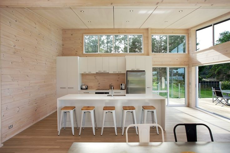 Lockwood holiday home with blonded solid wood interior and crisp white kitchen