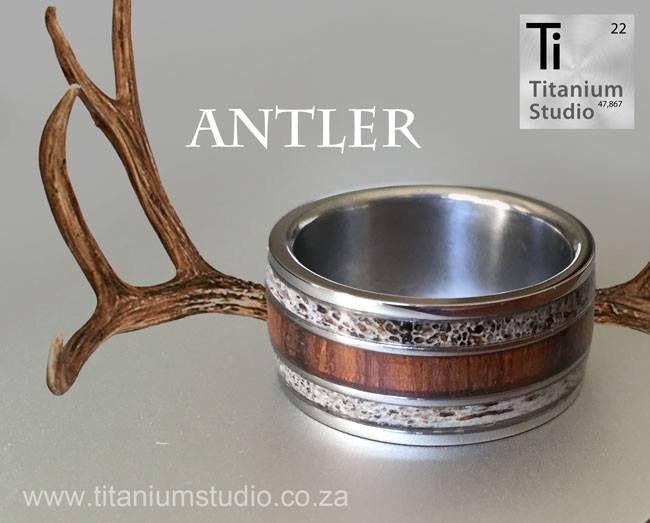 Deer antler and wooden inlay titanium ring.
