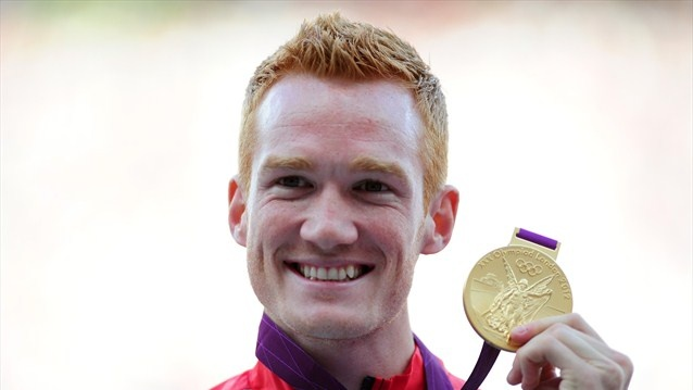 Gold medallist Greg Rutherford of Great Britain poses on the podium for Men's Long Jump on Day 9 at the Olympic Stadium