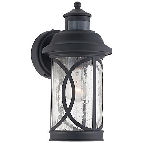 Illuminate your home with this outdoor wall light. Seeded glass is framed in black finish steel. With the convenience of both dusk-to-dawn and motion sensors, the light offers security and an aesthetically pleasing way to brighten up outdoor areas.