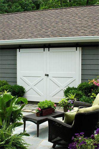 Sliding Barn Doors would be great as outdoor shutters on art studio window by street