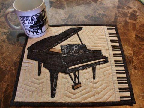 Paper Pieced Piano block made into mug rug. Piano keys border added.