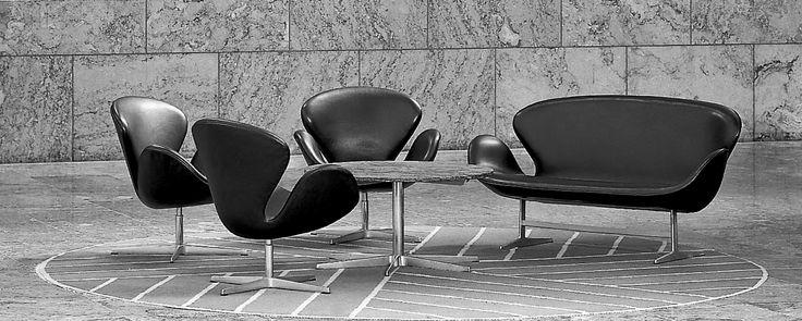 The Swan™ chair and Swan™ sofa by Arne Jacobsen / Fritz Hansen. Danish National Bank. Sorensen Leather: Classic / Black. #arnejacobsen #fritz_hansen #sorensenleather