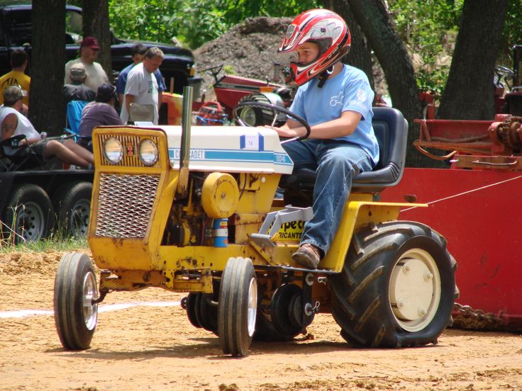 Garden Tractor Pulling! There is nothing more fun to watch at the county fair! Check out the article! #tractorpulling