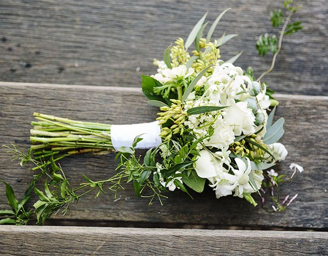 Meghan, carried a bouquet of silvergum, flannel flowers, roses, freesias, anenomes, poppy pods and jasmine vine by Bower Botanicals.