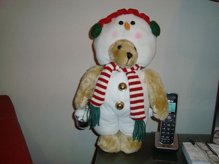Bear in snowman suit with bucket of snowballs