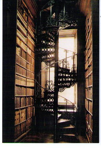 books and ornate spiral staircase