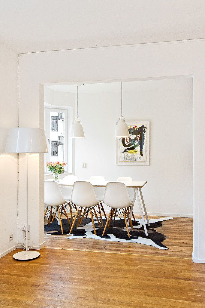 saving up for my own white eames chairs, can't wait. love the cow rug!