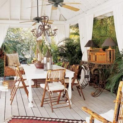 This Key West cabana is framed by heavy canvas draperies tied back with raffia-and-shell tassels.