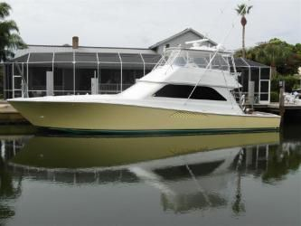 55' VIKING: This Viking 55 has 3 staterooms and two heads, full galley up equipped with the finest appliances, 3 TV's and VCR's, and beautiful interior teak woodwork throughout.