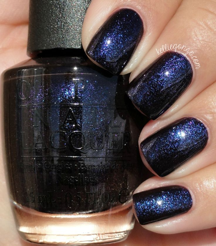 OPI Cosmo With A Twist is a deep purple, almost black, jelly filled with color shifting shimmer flecks in purple and blue