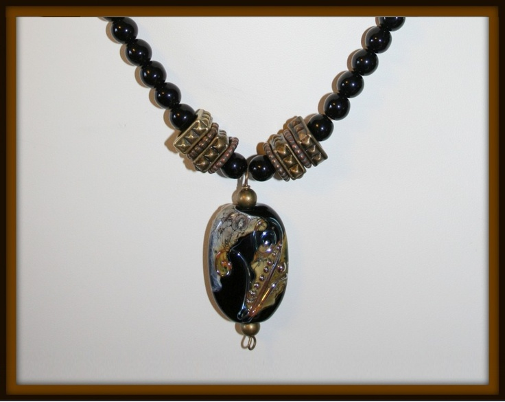Black Gold - Wonkets Necklace (lampworking) - This dark and stunning piece is made from black glass beads. It has antique gold findings, which set off the beautiful Wonket focal drop.