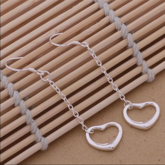 NEW .925 Silver Open Heart Dangle Earrings Brand new. Sterling silver plated. Matching necklace and stud earrings also available, listed separately. *More pictures to be posted* NO TRADES Jewelry Earrings