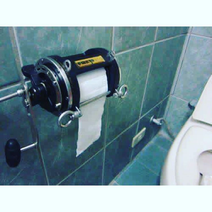 The Captain's Toilet. How to use an offshore fishing reel for a toilet paper dispenser.