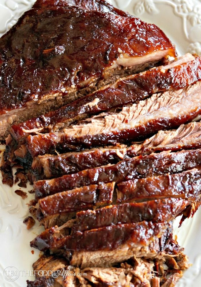 Tender oven cooked barbecue brisket is marinated overnight and baked for 5-6 hours for melt in your mouth tender meat!
