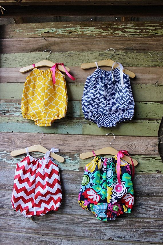 This simple bubble romper is available in your choice of fabric. Choose from a yellow summer honey, blue greek, red chevron, or multi colored