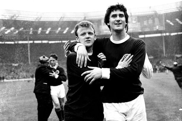 """Jim Baxter, right, with Billy Bremner after Scotland's famous 3-2 win over England in 1967. Slim Jim absolutely destroyed the """"World Champions"""" at Wembley"""