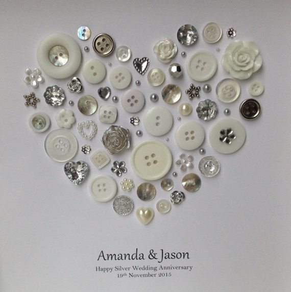 A beautiful wedding anniversary gift to celebrate 25 years of marriage.  Made using white, silver and pearl buttons and embellishments that are shaped in to a heart.  Add your own message to make something truly personal and unique. Please see the alternative version in my shop :)  **Ordering Info** After youve added to cart there is a note to seller box where you can give me all the personalisation details you would like me to include on your artwork.  Artwork comes in a 25cm x 25cm x 4cm…