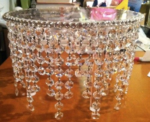 Chandelier cake stand (picture only). How Beautiful !!  Glue chandelier beads to your cake stand and glue clear rhinestone trim around the top.