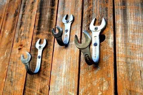 Hangers from old wrenches that you bend and drill in the wall, Cute for a boy's room.