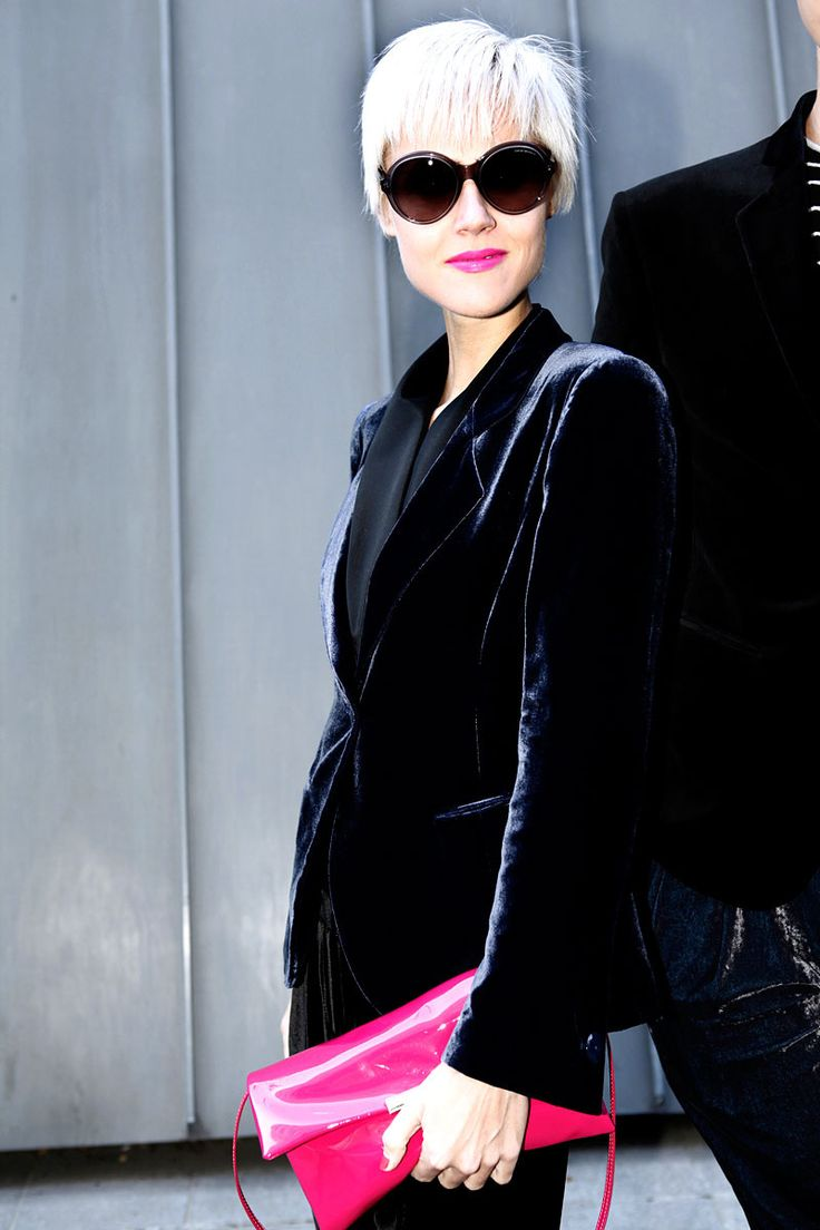 Love the whole concept of this 'street style' look:short platinum hair,retro-inspired eyewear,dark velvet blazer with contrasting neon accents on lips,nails and patent leather purse.
