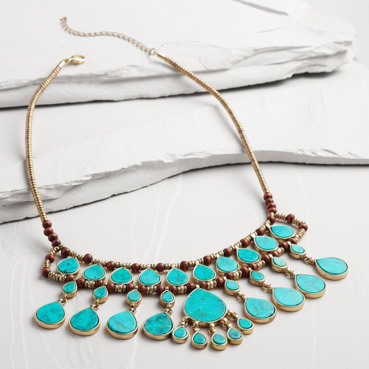 Gold and Turquoise Layered Teardrop Statement Necklace -- With vibrant turquoise stones layered with gold detailing, our handmade statement necklace creates a fresh take on vintage design.
