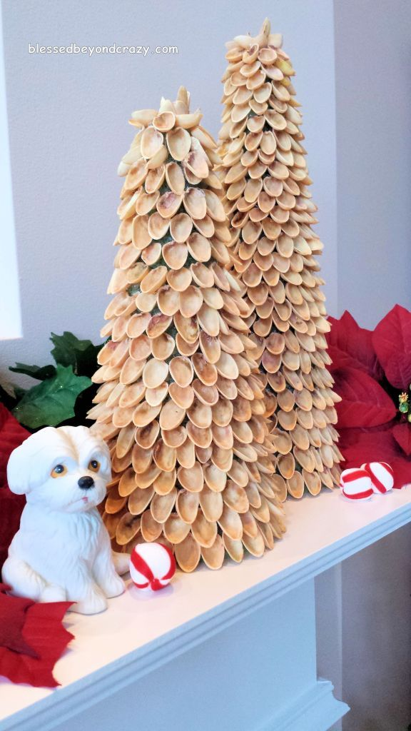 DIY Mini Pistachio Christmas Trees - it only takes a hot glue gun and several glue sticks, a Styrofoam tree form, empty pistachio shells and about 35 minutes to make a rustic/primitive Christmas tree. They blend well with various Christmas decor and someone suggested that they look wooden. (Click on the pic to see these in various Christmas settings).