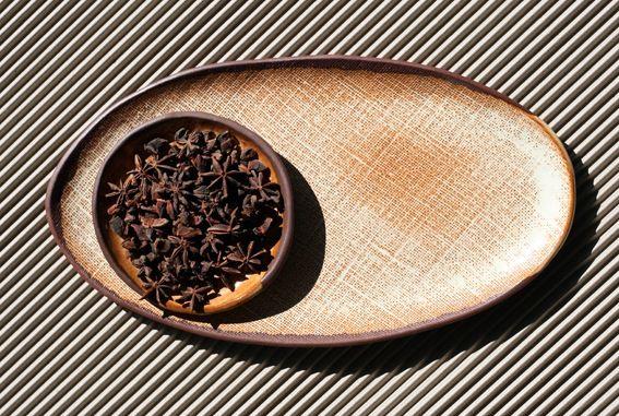 Terracotta Hessian impressed oval platter with a creamy satin glaze. 350mm long.