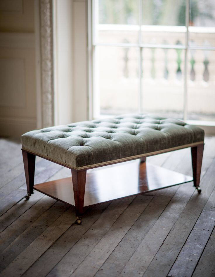 Ottoman table with deep buttoning. A wonderfully practical and elegant design incorporating a shelf. Perfect for a stack of coffee table books.