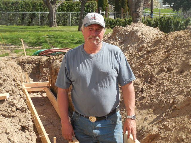 Gary, owner of Apple Valley Well Drilling, checking forms before pore of concrete!