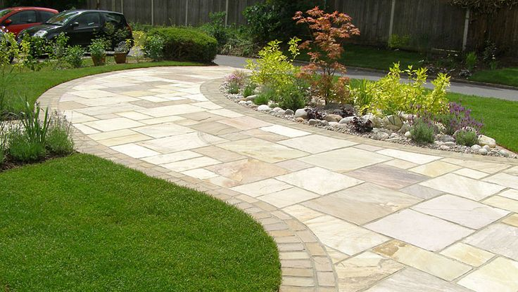 Front Driveway Idea - stamped concrete, bordered by bricks or pavers.