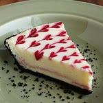 White Chocolate Raspberry Cheesecake  With Pink Raspberry hearts
