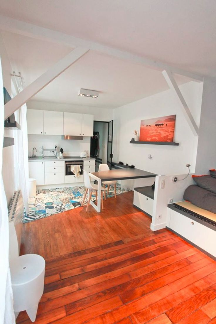 small parisian studio apartment is packed with great storage solutions