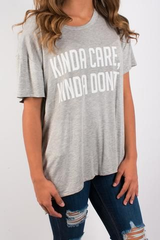 Kinda Care, Kinda Don't grey flowy graphic tee. 75% Polyester | 25% Vicose
