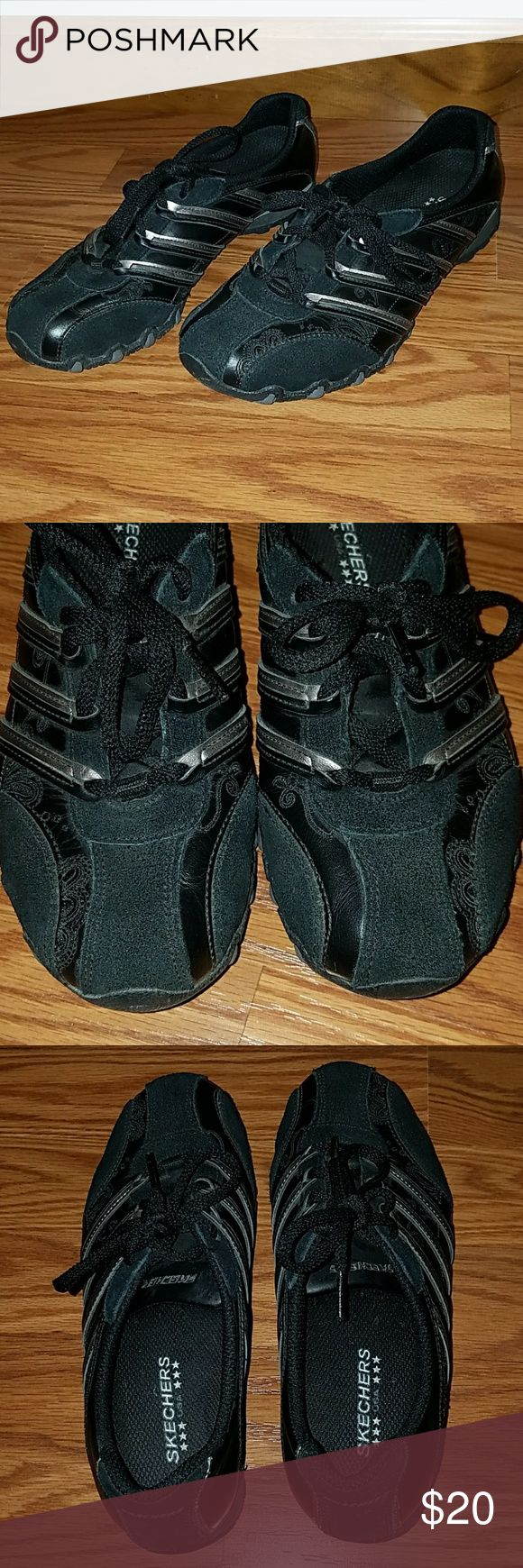 Skechers black low profile active shoe Skechers black with silver stripe active shoe. Low profile cut. Perfect condition,  no wear inside or outside. EUC, smoke free home Skechers Shoes Sneakers