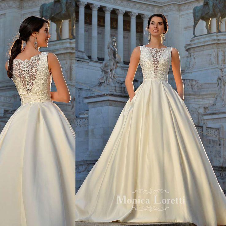 Vestito da sposa in pizzo bianco e gonna in raso articolo Claudia Monica Loretti