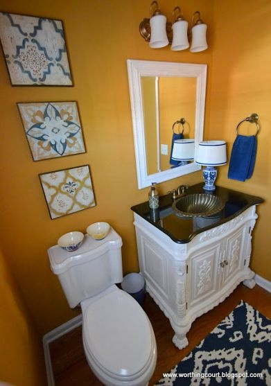 Patterns galore in this bright blue  orange bathroom. The vanity is really stunning as well! By @worthing court suzy handgraaf
