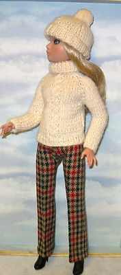 Hand knit cabled turtleneck sweater + hat + wool slacks.