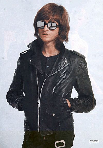 1980-2008 Costume for Men. The Perfecto motorcycle jacket became popular in the 70's and was worn throughout the 80's and 90's by men and women alike. It re birthed from the 1950's when Marlin Brando had given it symbolism as something worn by the rebellious youth.