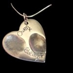 Large Double Heart Fingerprint Charm. Room for Two Fingerprints and Two Names. Keep your loved ones finger prints close to your heart with this beautiful charm. Your nearest Keepsake Artist will discuss your requirements with you and make the charm to your requirements.