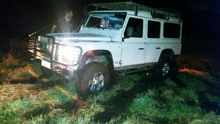 A stuck Land Rover Defender in very wet parking area at the Knysna Speedfestival in the process of being recovered by a Jeep Wrangler. Jeep Wrangler, rated as one of the best 4x4's of the century! #jeep #jeepwrangler #teamstanmar