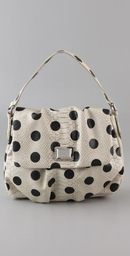 White bag with black polka dots